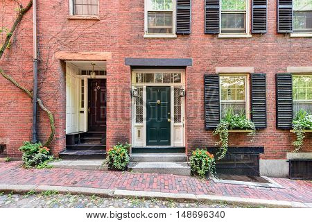 Boston, Massachusetts - September 5, 2016: Acorn Street in Boston Massachusetts. It is a narrow lane paved with cobblestones that was home to coachmen employed by families in Mt. Vernon and Chestnut Street mansions.