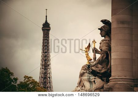 Statue of Alexandre III bridge over River Seine with Eiffel Tower in Paris, France.