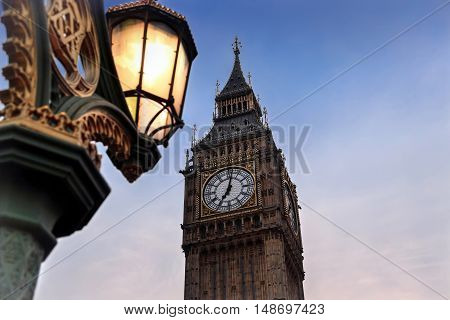 Close up of London street light and Big Ben at sunset