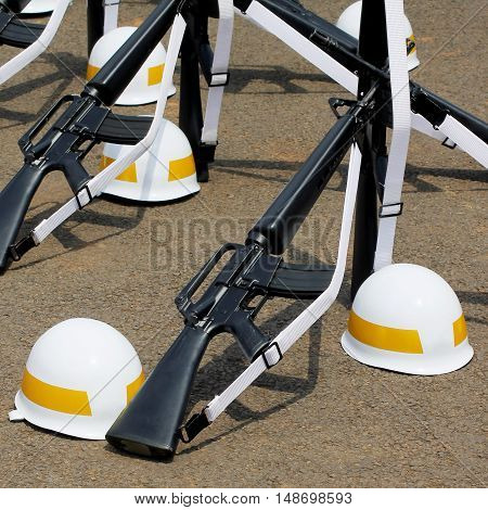 Rifles And Yellow Striped Helmets