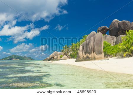 Famous view at beautifully shaped granite boulders and a perfect white sand at the famous Anse Source d'Argent beach, La Digue island, Seychelles