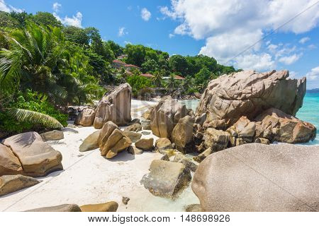 Beautifully shaped granite boulders and a perfect white sand at the Anse Patates beach, La Digue island, Seychelles