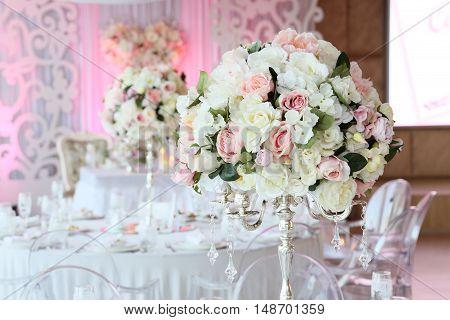 Beautiful bouquet of roses in wedding decor restaurant interior