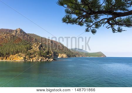 The mountain ranges surrounding lake Baikal in some places, approach almost to the shore.