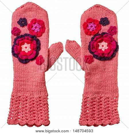 The pink mittens placed on white background. Mittens have connected by spokes