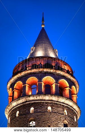 Famous Galata tower in Istanbul, Turkey. The Romanesque style tower was built as Christea Turris (Tower of Christ) in 1348 during an expansion of the Genoese colony in Constantinople.