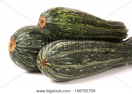 Three green zucchini isolated on white background.