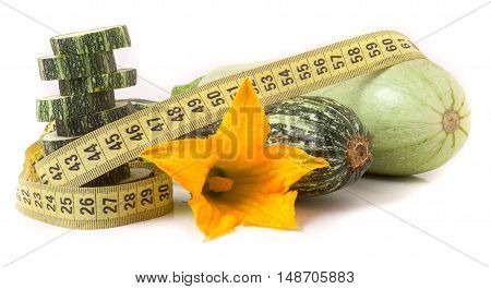 zucchini with measuring tape isolated on white background.