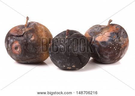 three rotten apple isolated on a white background.