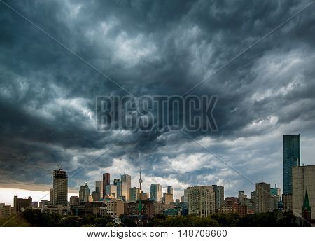 A city in the background with heavy clouds before a storm