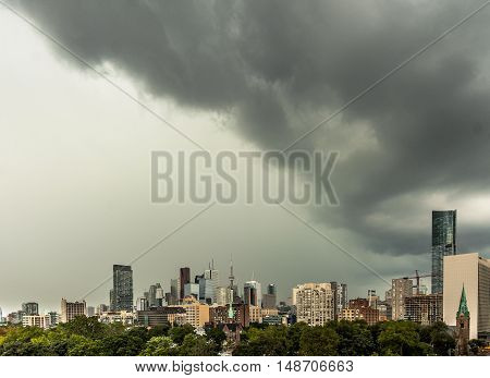 An incoming storm approaching the centre of the city.