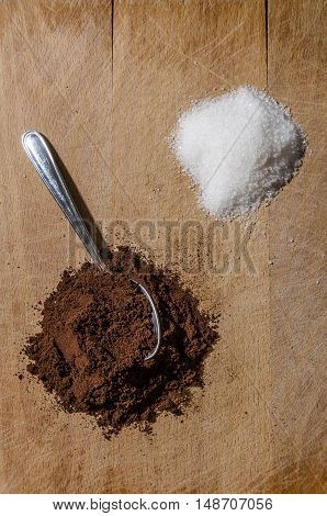 still life with a pile of coffee and one pile of white sugar