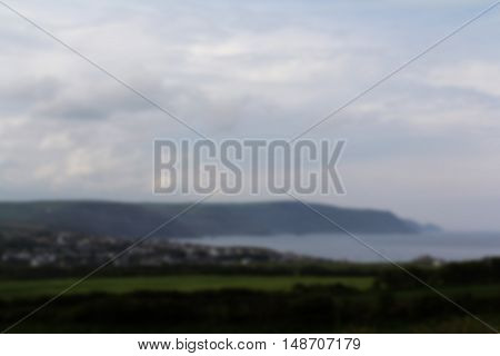 View Over The Coastline Near Bude In Cornwall Out Of Focus.