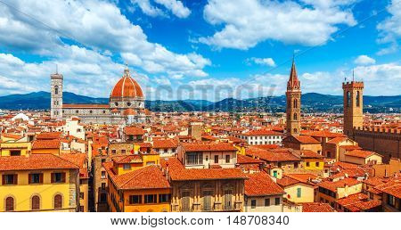 Cathedral Santa Maria del Fiore in Florence. View to old town with red tegular roofs
