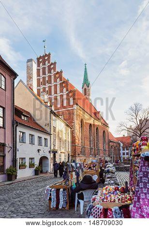 Saint John Church And Stall In Old Riga At Christmas