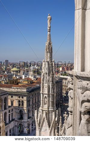 Aerial view of Milan from Duomo roof terrace, Italy. In the distance is the dome Civico Tempio di San Sebastiano.