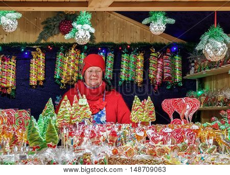Seller At Stall With Colorful Candies On Vilnius Christmas Market