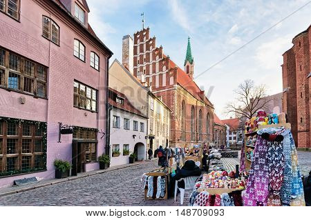 St John Church And Stall In Old Riga At Christmas