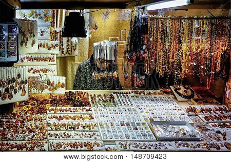 Woman Selling Amber Embellishments In Riga Christmas Market