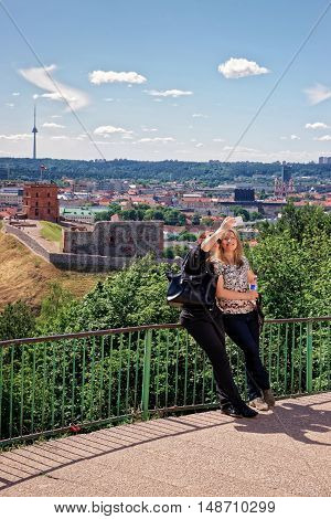 Women Making Selfie With Gedimino Tower And Lower Castle Vilnius