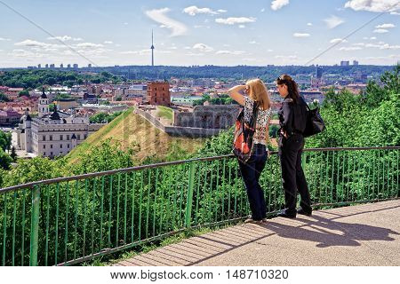 Women Viewing Gediminas Tower And Lower Castle In Vilnius