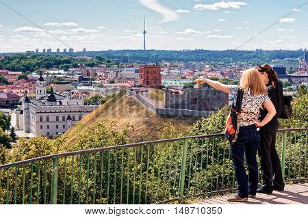 Women Viewing Gediminas Tower And The Lower Castle In Vilnius