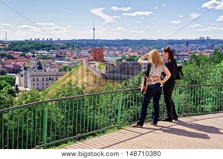 Women Viewing The Gediminas Tower And The Lower Castle Vilnius