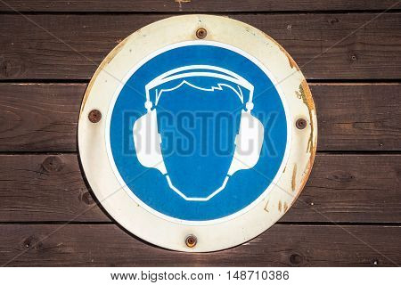 blue ear muff symbol on wood texture