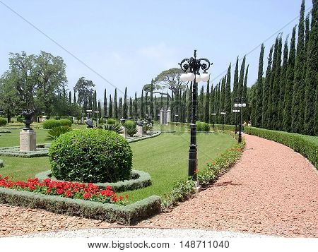 Red Path and cypress in Bahai garden in Akko Israel