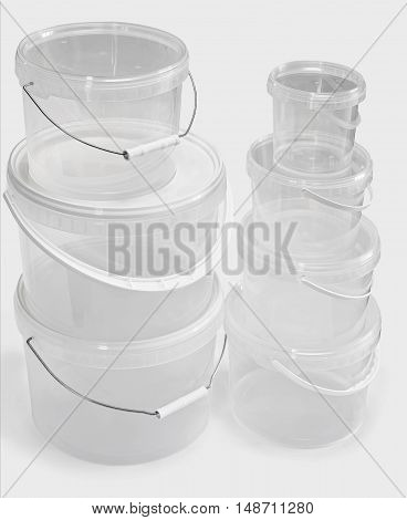 Clear Plastic Buckets Isolated On White