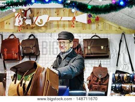 Smilling Man Selling Handmade Leather Bags At Vilnius Christmas Market