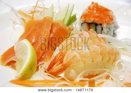 Assorted sashimi and sushi salmon and ebi prawn maki
