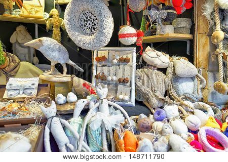 White Handmade Souvenirs On Stall At Riga Christmas Market