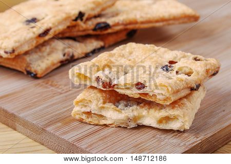 Puff Cookies With Raisins On A Cutting Board Made Of Bamboo.