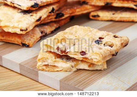 Puff Cookies With Raisins On A Cutting Board Made Of Bamboo Stripes.