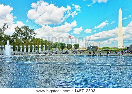 Fountain In Wwii Memorial With Washington Monument In The Back
