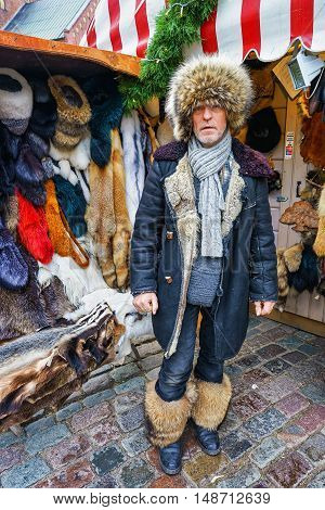 Latvian Man Dressed In Fur Clothes At Riga Christmas Market