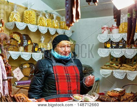 Latvian Woman Selling Traditional Goods At The Riga Christmas Market