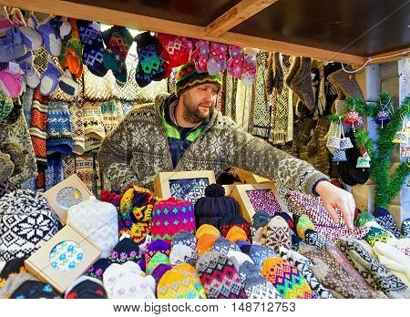 Man Selling Warm Clothes At Riga Christmas Market