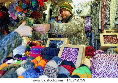 Man Selling Warm Mittens And Socks At Riga Christmas Market