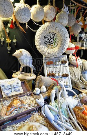White Handmade Souvenirs On The Stall During Riga Christmas Market