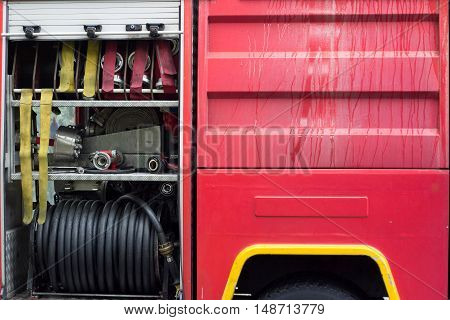 Firemen answering the call - detail of firetruck