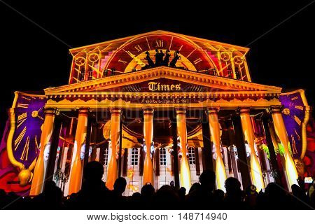 MOSCOW RUSSIA - SEPTEMBER 24 2016: The Circle of Light Moscow international festival. State Academic Bolshoi Theatre of Opera and Ballet illuminated for free open air performance.