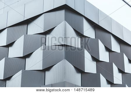 Angle of black metal wall of futuristic building. Abstract architectural pattern