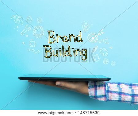 Brand Building Concept With A Tablet