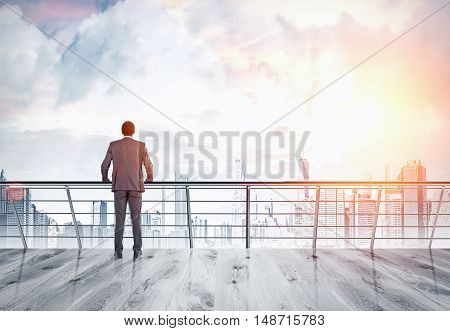 Rear view of African American businessman in suit looking at large city panorama with skyscrapers. Concept of leadership in business. Toned image.