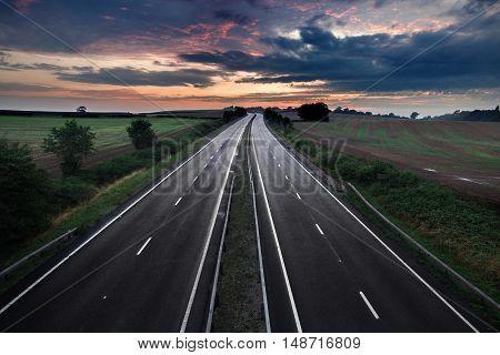 Empty Asphalt Road with Moody Twilight Sky.tif