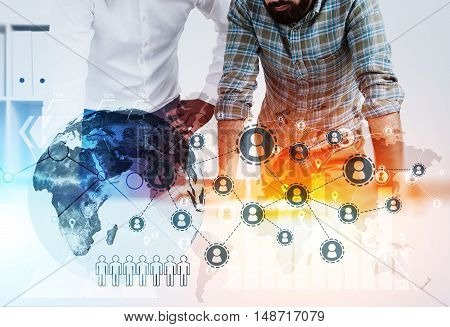 Two businessmen in casual clothes standing near table in office. Startup sketch and globe at the foreground. Concept of international trading. Toned image. Double exposure