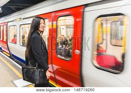 Chinese Woman Waiting At Tube Station