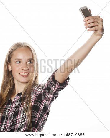 cute teenage girls making selfie isolated on white